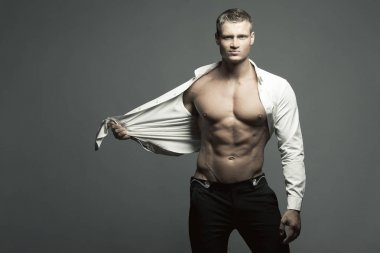 Male beauty, fashion concept. Portrait of handsome muscular male model