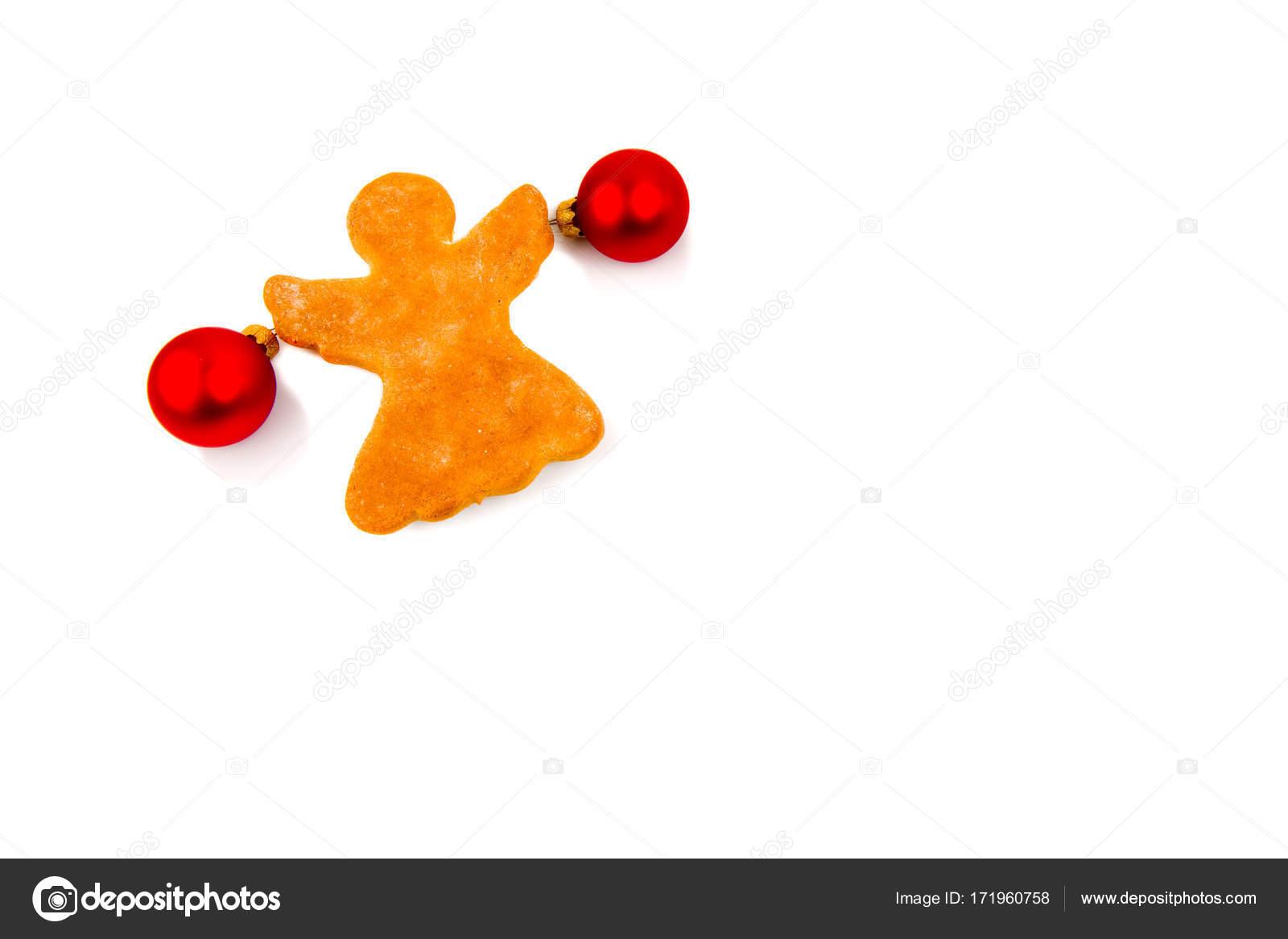 Biscuit de gingembre sous la forme d'un ange avec des boules ...