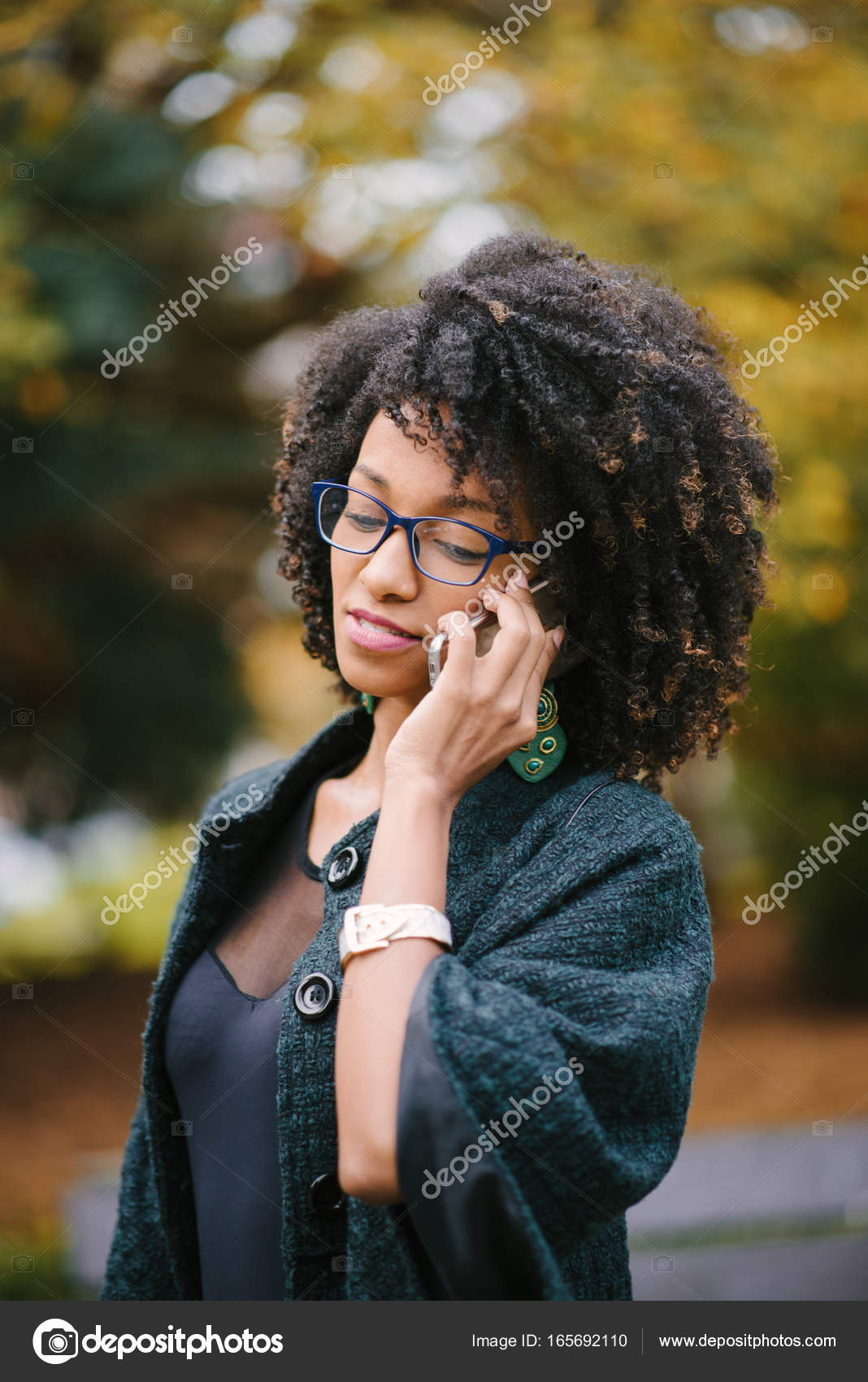 Black Woman During A Mobile Phone Call In Autumn Stock Photo