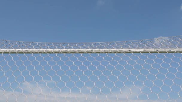 SLOW MOTION: Soccer ball flies into a gate (bottom view)