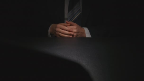 Bribe: Businessman hesitate puts out a money bundle on a table - two person
