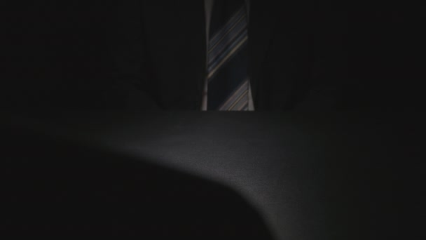 Bribe: Businessman cautiously takes out from under table a money pack on a table - two person (euro)