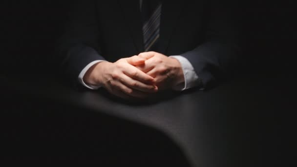 Bribe: Businessman cautiously takes out from a suit a money pack on a table at negotiation time
