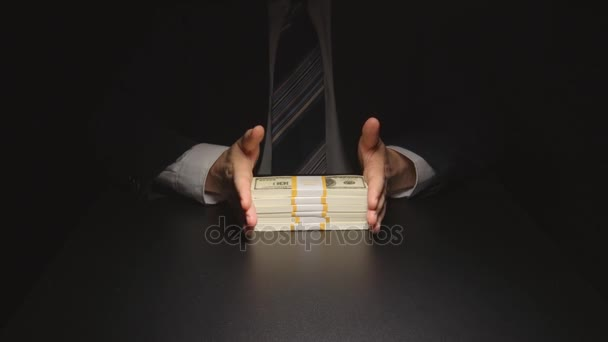 Bribe: Businessman waits, touches a money bundle and gives it