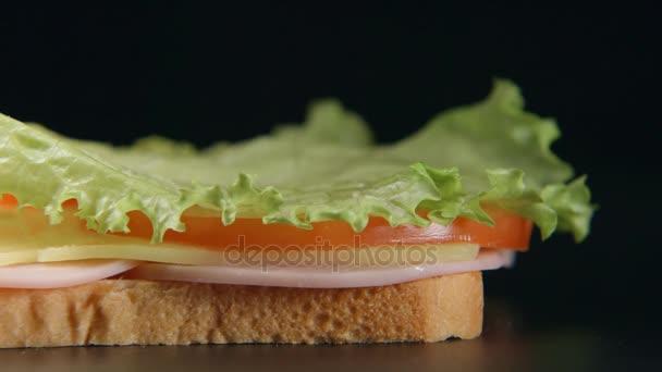 SLOW MOTION: Bread slice falls on a sandwich