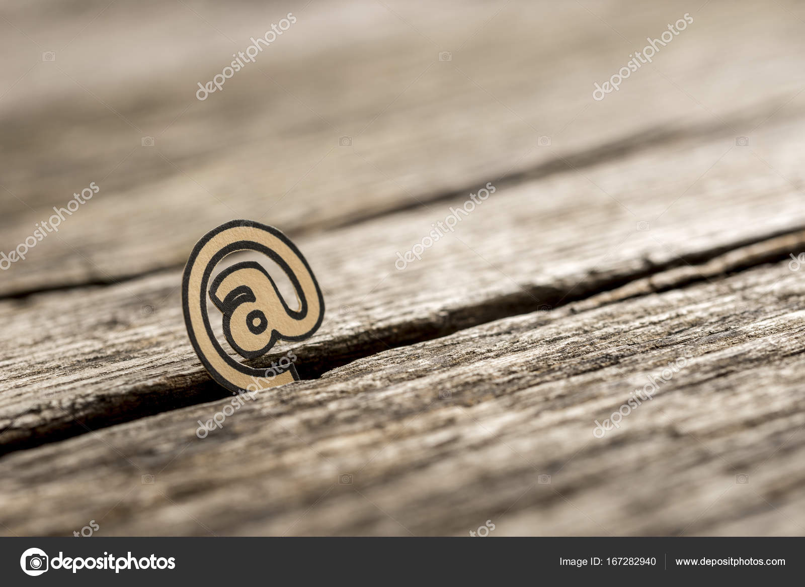 Small At Symbol Stuck In Between Wood Stock Photo Gajus Images