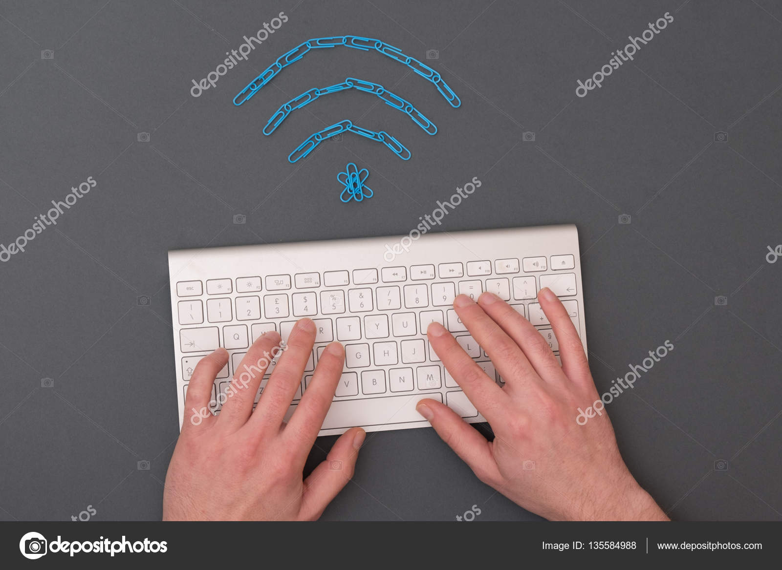 Wireless Signal Symbol Made Of Paperclips And Computer Keyboard