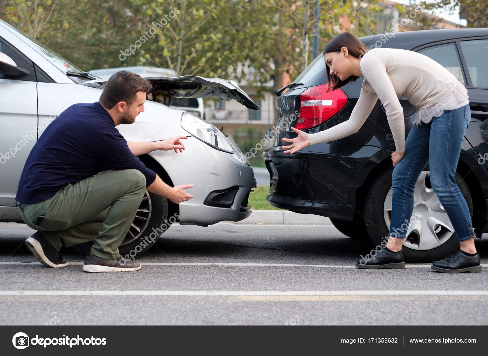 People examining car body damages after car hit stock photo people examining car body damages after car hit stock photo 171359632 platinumwayz