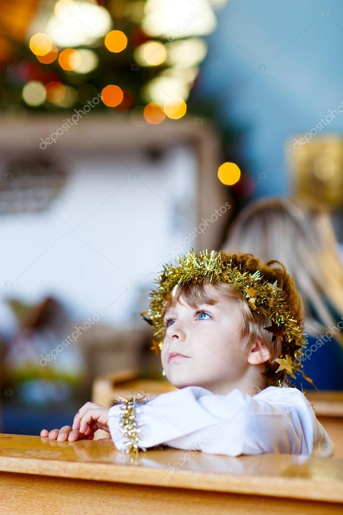 little kid boy playing an angel of Christmas story in church — Stock ...