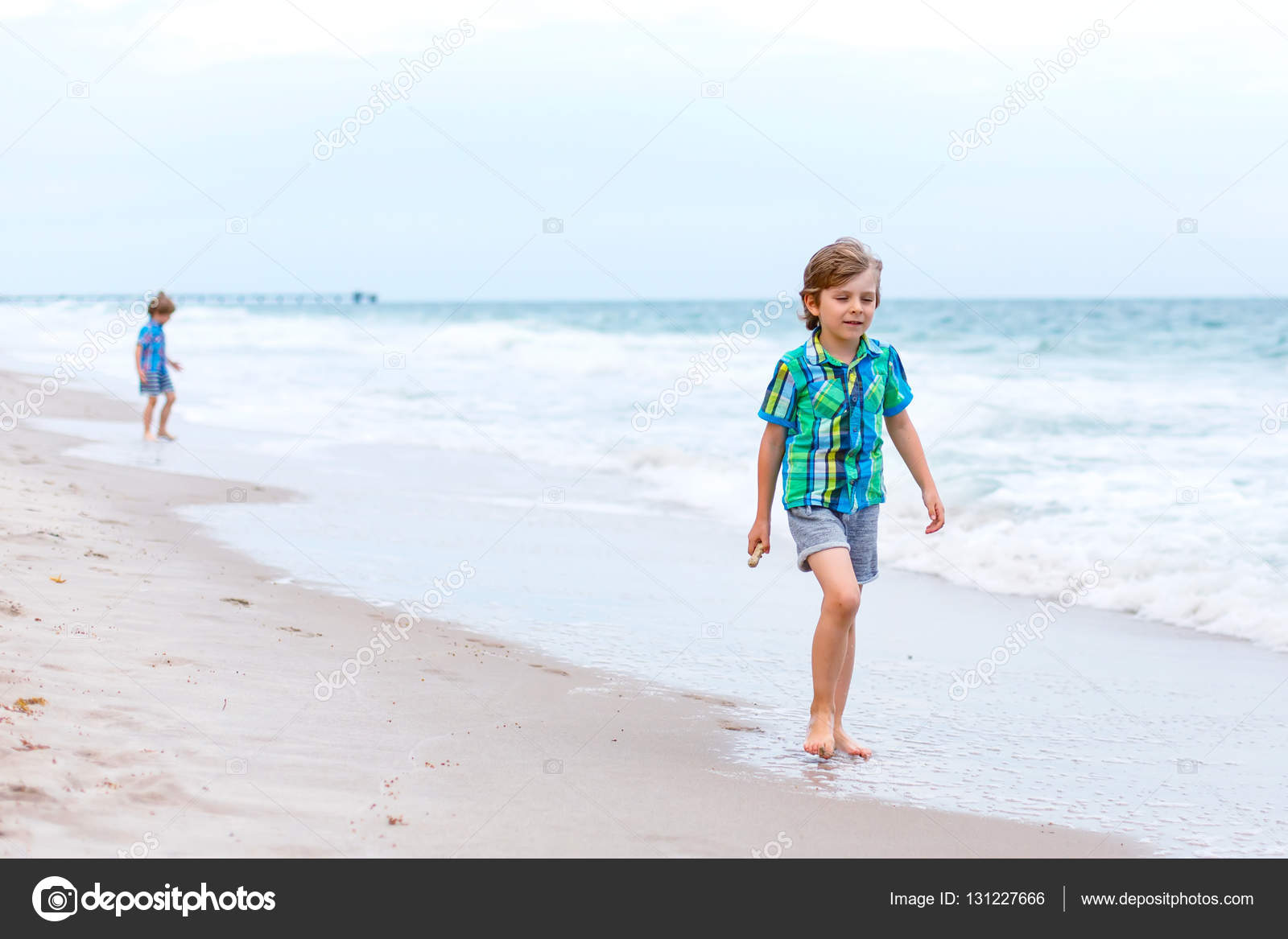 Two Little Kids Boys Running On The Beach Of Ocean Stock Photo 131227666