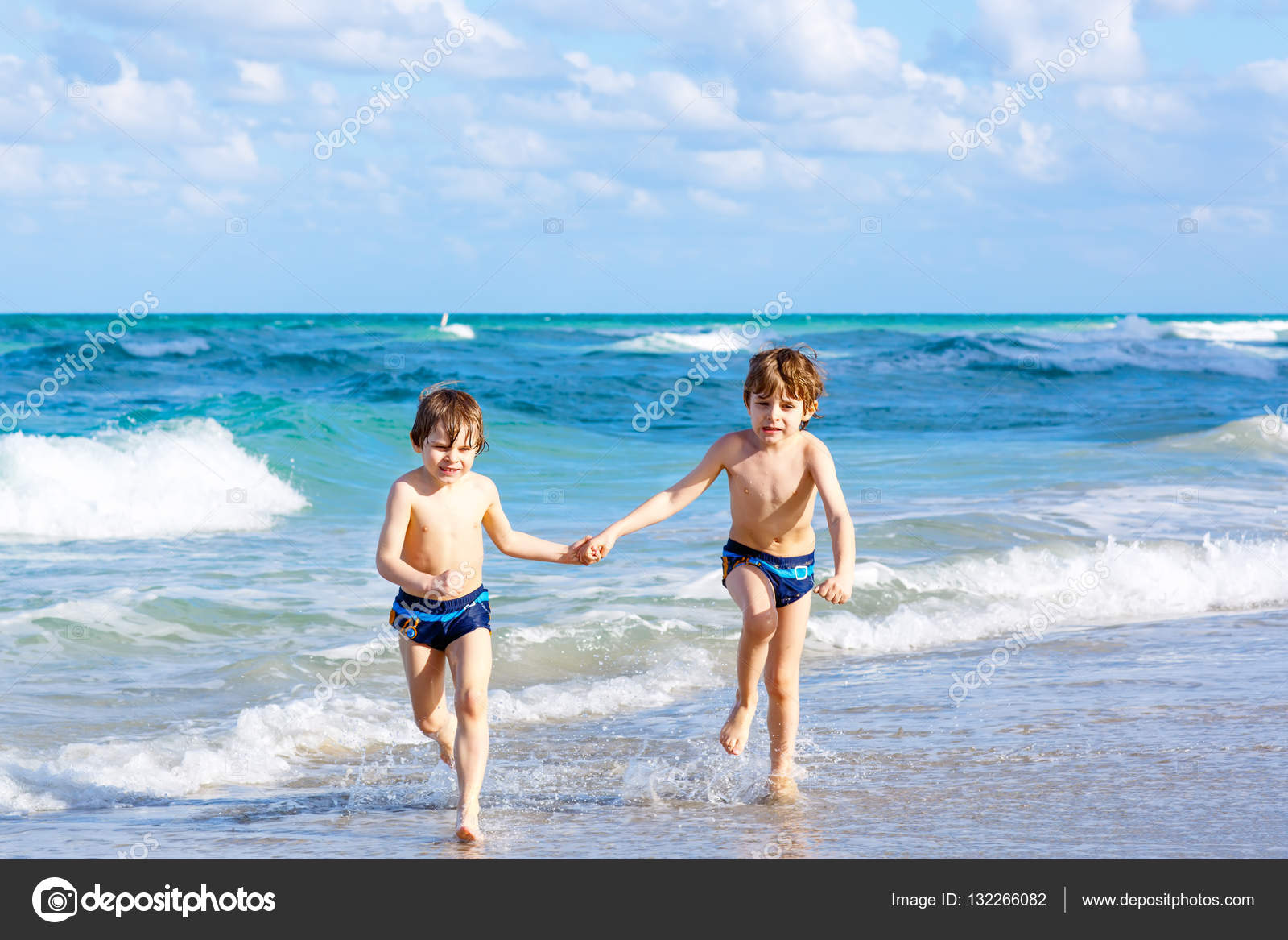 Two Kid Boys Running On Ocean Beach In Florida Stock Photo 132266082