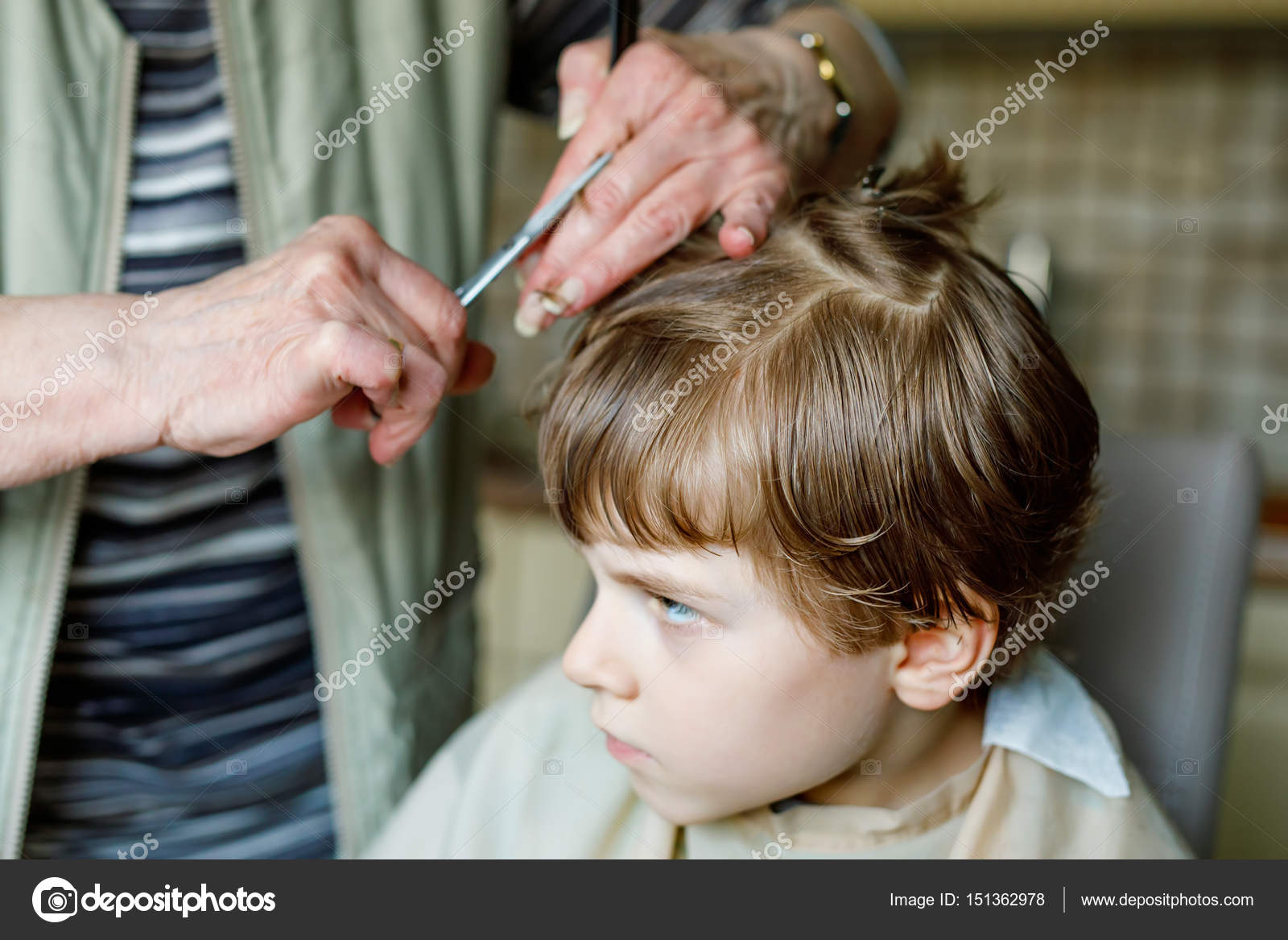 Beautiful Kid Boy With Blond Hairs Getting His First Haircut Hands Of Hair Stylist Cutting Curly Scissors Happy Child Sitting And Waiting