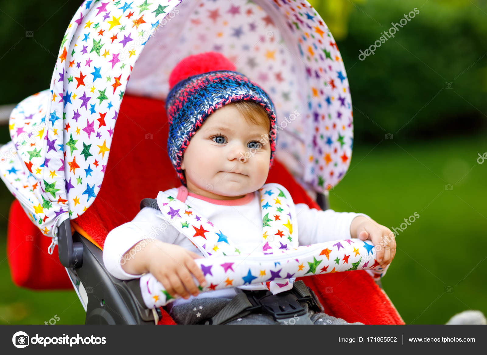 cute little beautiful baby girl of 6 months sitting in the stylish