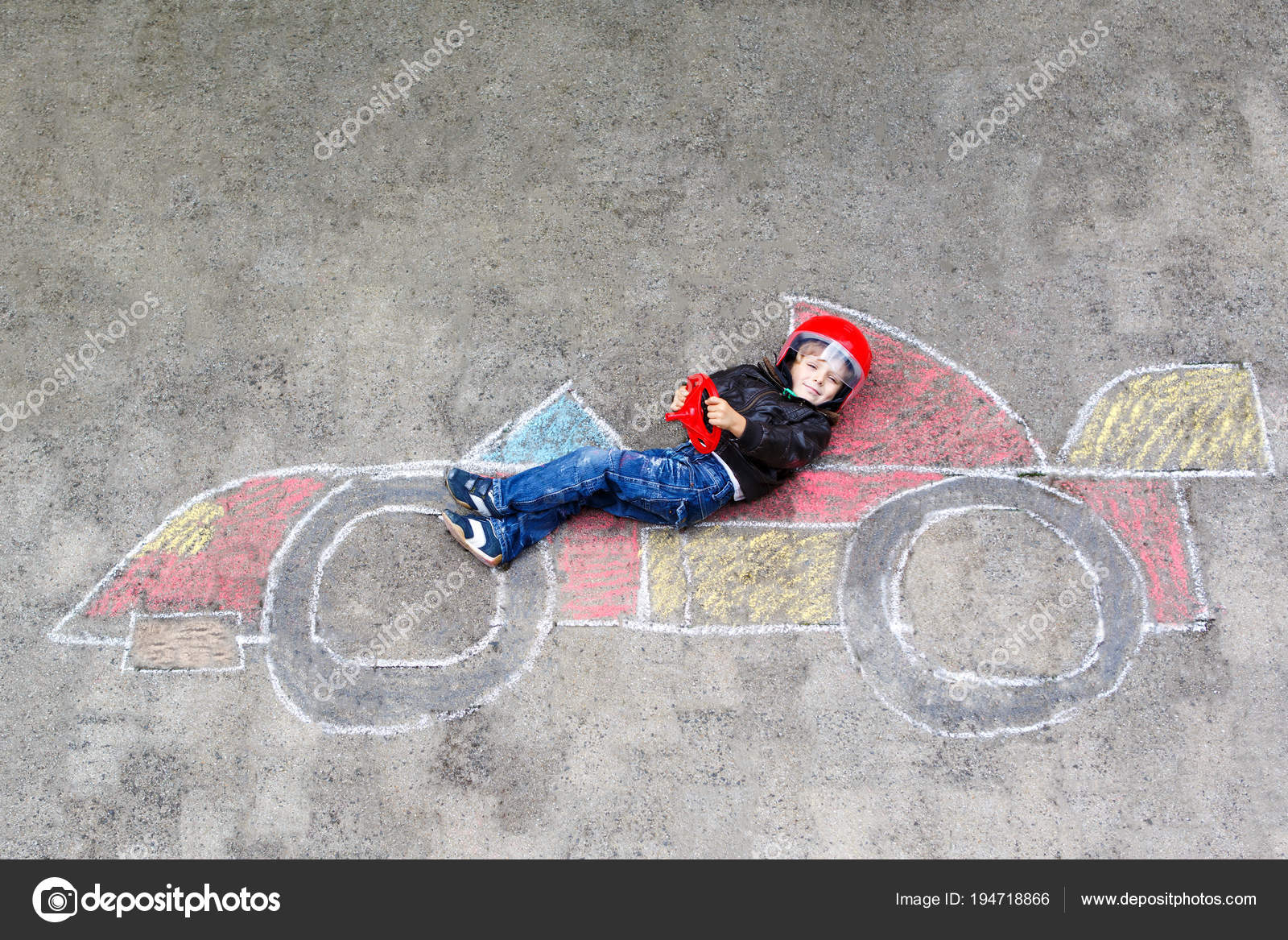 Adorable Little Kid Boy Drawing With Colorful Chalks Race Car