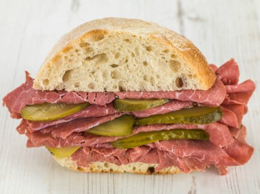 Salt Beef or Pastrami With Gherkins in a Ciabatta Bread Roll or