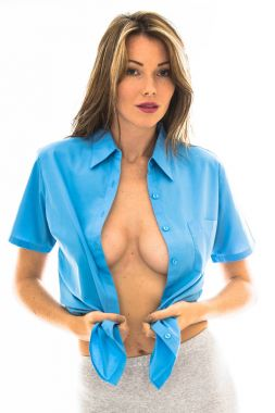 Attractive Sexy Young Woman Wearing an Open Man's Blue Shirt