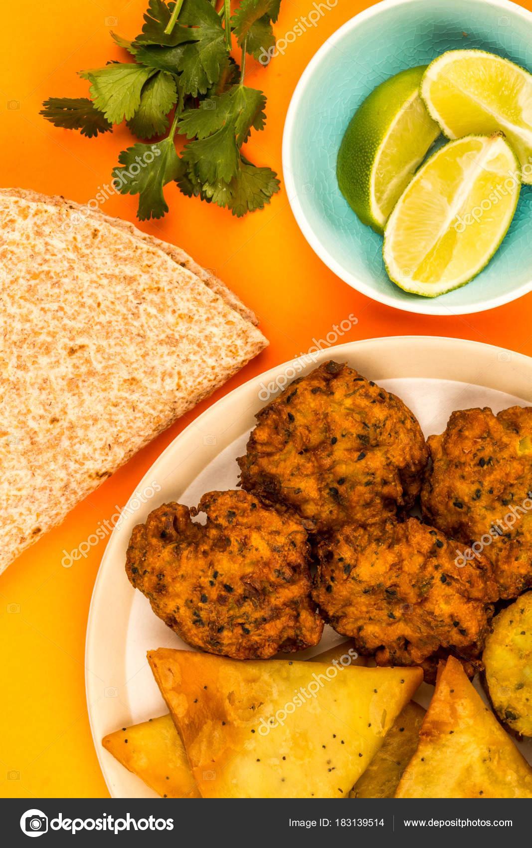 Indian food style snacks vegetarian tikka vegetarian samosa onion indian food style snacks vegetarian tikka vegetarian samosa onion bhaji stock photo forumfinder Gallery