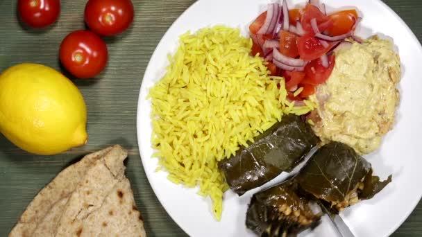 Stuffed Vine Leaves Dolmades With Hummus Salad And Rice