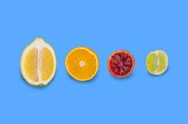 Fresh citrus fruits on an old blue background. Design concept. Selective focus.