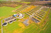 Photo Aerial view to biogas plant from pig farm in green fields