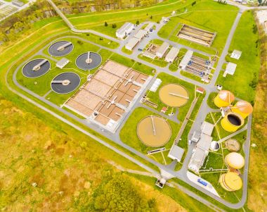 Aerial view to biogas plant from sewage treatment in green fields
