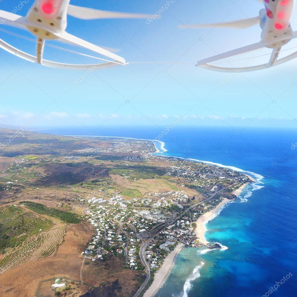 Aerial view to coral reef near Saint Paul village