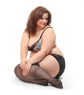 Overweight woman dressed in underwear