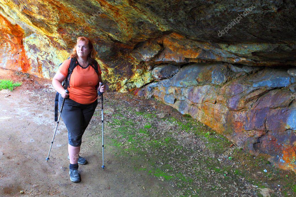 woman explore ancient underground mine