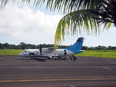 editorial tourist leaving plane Corn Island Airport Nicaragua