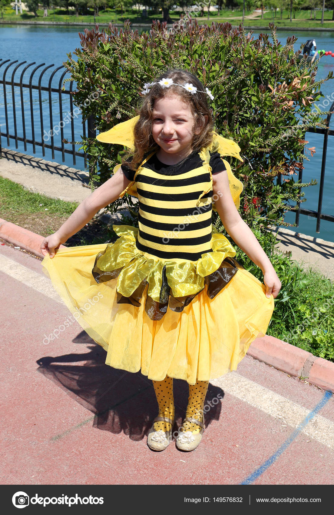 Unidentified Cute Little Girl With Bumble Bee Costume Posing At