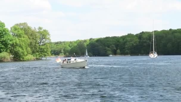 Sailboats and motorboats on havel river next to Potsdam (Germany)