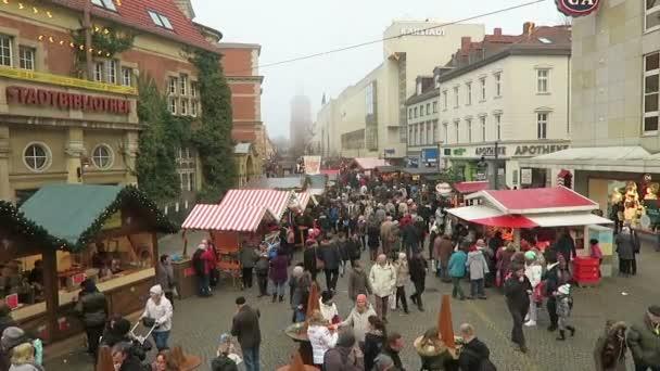 People walking over Christmas fair on Spandau district of Berlin.