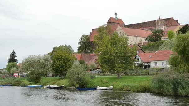 HAVELBERG, SAXONY-ANHALT/ GERMANY September 16 2015: historical cityscape of Havelberg with traditional brick houses and harbor. the boat turning around in circle. bridge with traffic.
