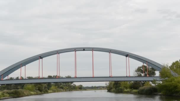 Bridge of Strodehne. driving with boat along Havel river. typical landscape with meadows and willow tries. Havelland region. (Germany)