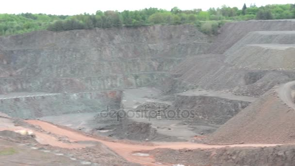 BEBERTAL, SAXONY-ANAHLT / GERMANY June 04 2016: Earth mover ready to loading a dumper truck in a quarry, surface mine. typical mining industry.