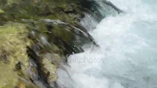 Zillertal Alps stream water flowing over rocks.