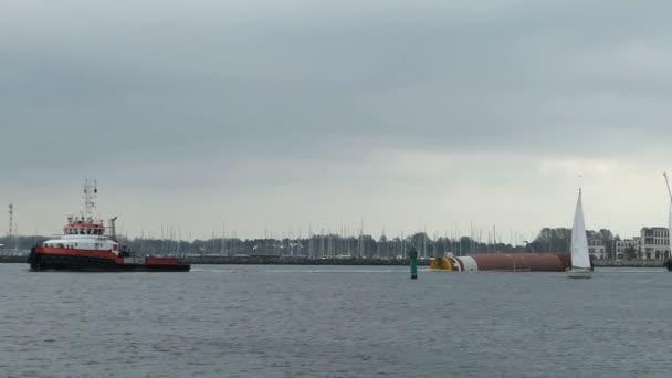 Industrial ships leaving the harbor of Rostock Warnemuende towards Baltic sea