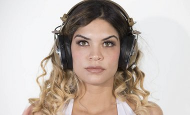 closeup of a sexy girl listening to music