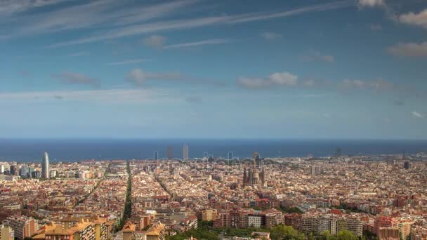 wide angle time lapse of barcelona shot from bunkers de carmel offering amazing panoramic views over the city skyline