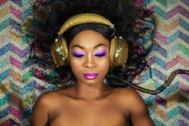 disco diva sexy dj listening to music with headphones