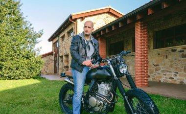 Man riding custom motorbike