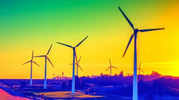Větrné turbíny při západu slunce