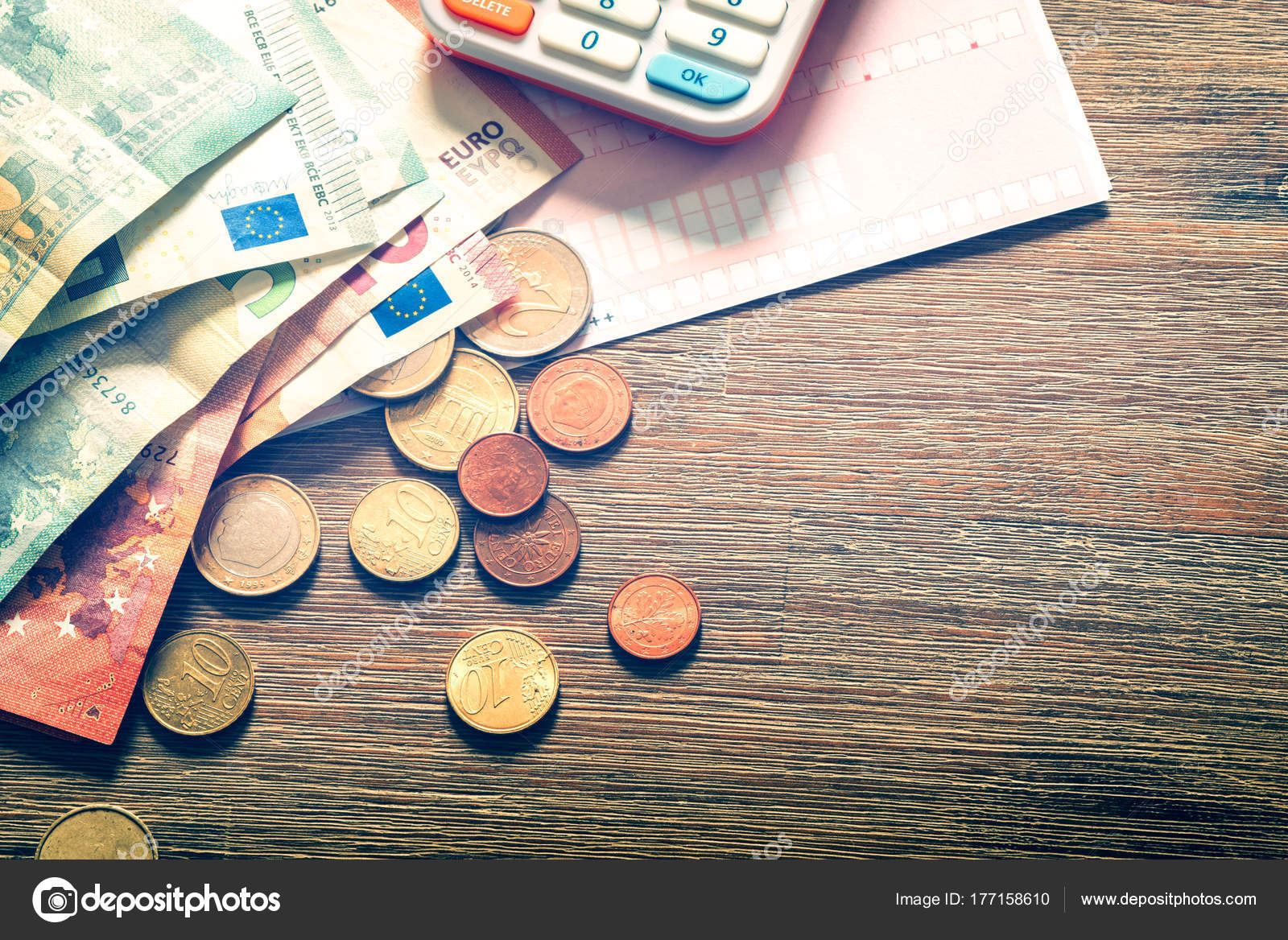 Euro Banknotes And Coins With Bills To Pay Stock Photo