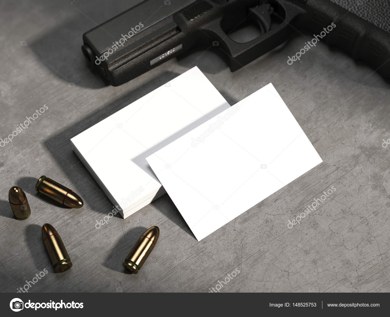 White business cards on concrete floor with gun and bullets ...