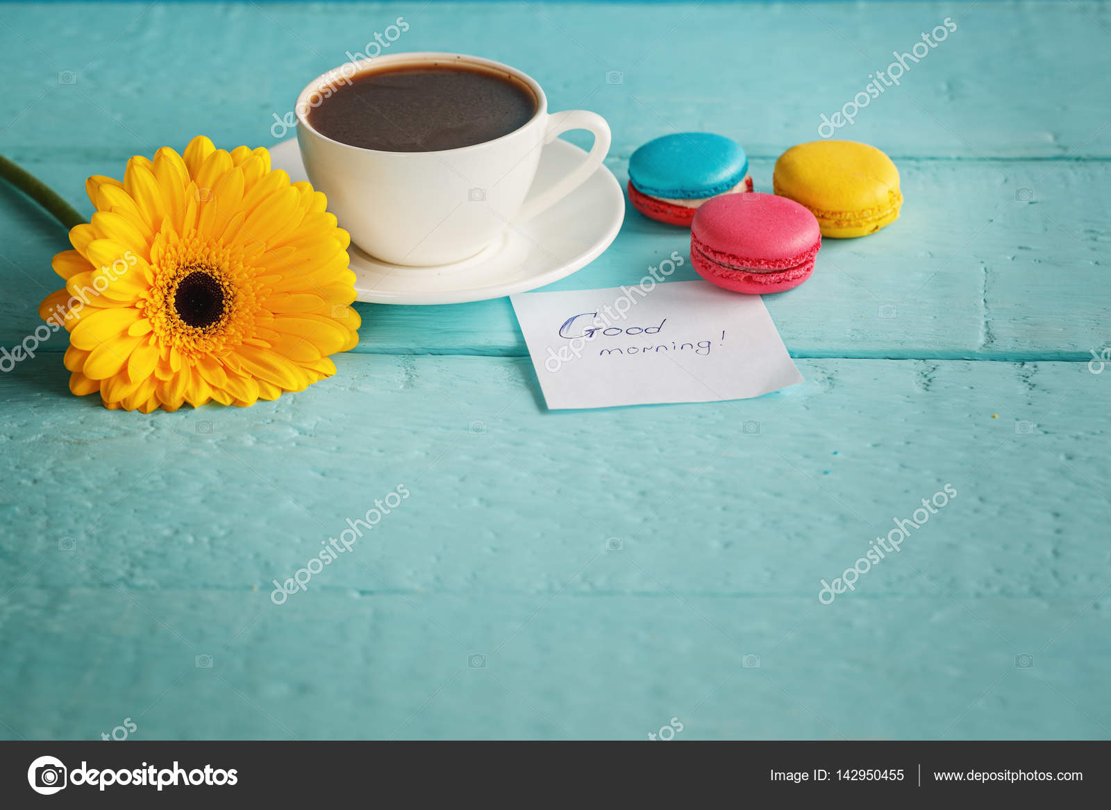 Cup Of Coffee Or Tea With Yellow Flower And Macaroons On Blue