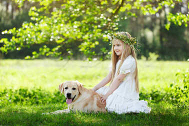 LIttle girl and big dog bestfriend on nature background