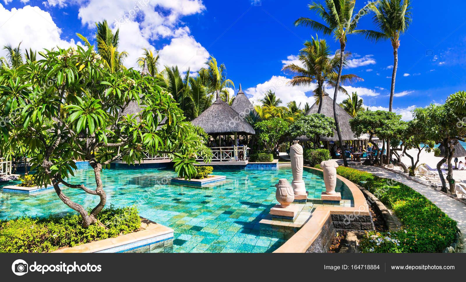 Tropical holidays - swim pool area and bar near the beach ...