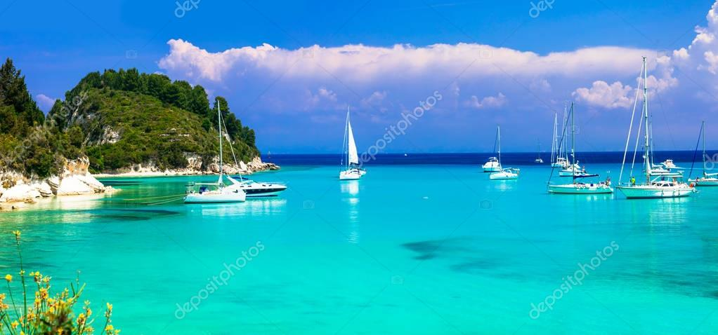 Beautiful turquoise bay Lakka in Paxos with sailing boats. Greece.
