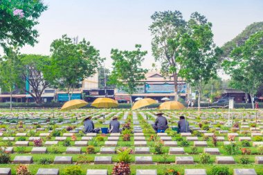 KANCHANABURI THAILAND - FEBRUARY 21 : Unidentified Workers renovate and decorate flowers at Kanchanaburi Allied War Cemetery on February 21,2020 in Kanchanaburi, Thailand