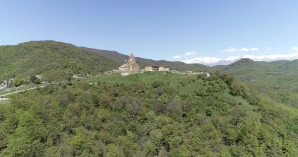 Approach to monastery with snow mountains on background. 426 14116 09 2